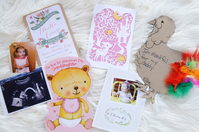 Little girl keepsakes including greeting cards, ultrasound picture, invitations and crafts